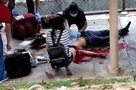 AID: Paramedics and a passer-by attempting to resuscitate the victim.