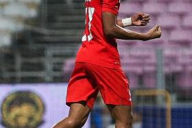 THUMBS UP: LionsXII winger Faris Ramli (above) says top local players will be fighting to get into the Asean Super League team.