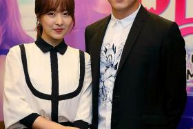 FLIRTATIOUS: Park Bo Young (above, left) plays a woman possessed by a flirtatious ghost who is trying to seduce her boss, played by Cho Jung Seok, using various methods