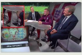 Wayne Rooney (second from right) on a panel with Roy Hodgson (extreme right).