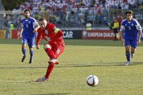 FEAT: Wayne Rooney (in red) converting the penalty against San Marino for his 49th England goal.