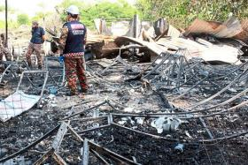SCORCHED: What was left after the blaze at the 70-yearold Mioa You temple in Kuala Lumpur.