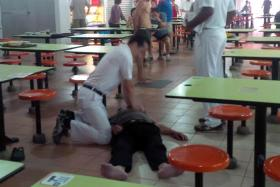 QUICK THINKING: Dr Koh Poh Koon performing CPR on the man at Ang Mo Kio Central Market & Food Centre yesterday morning.