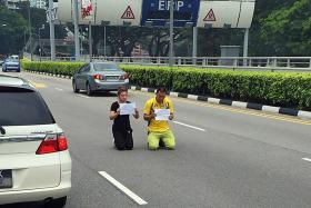 A man and a woman were spotted kneeling and shouting in the middle of Bendemeer Road on Aug 24, 2015.