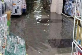 COMMON OCCURRENCE: The stretch of 23 shops at Block 504, Jurong West Street 51, hit by flooding after a heavy downpour yesterday afternoon.