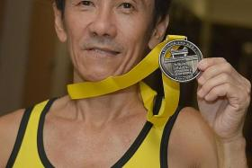 RUNNING ON: Mr Hanniel Choong, 54, has joined the Yellow Ribbon Prison Run almost every year since it started in 2009.