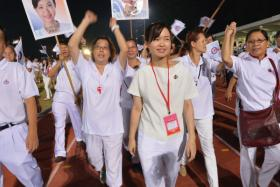 Tin Pei Ling, the MP for MacPherson SMC at Bedok Stadium with supporters