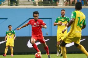 DISAPPOINTING: Shahdan Sulaiman's (in red) deflected equaliser saves LionsXII's blushes.