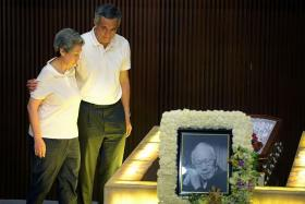STRONG-WILLED: PM Lee Hsien Loong and his wife Ho Ching paying their last respects to Mr Lee Kuan Yew on March 29.