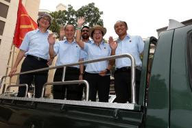 WINNERS: The Workers' Party team in Aljunied GRC, made up of (from left) Mr Chen Show Mao, Mr Low Thia Khiang, Mr Pritam Singh, Miss Sylvia Lim, and Mr Muhamad Faisal Abdul Manap, before their Thank-you Procession yesterday.