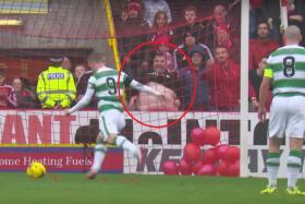 A fan tries to distract Celtics' Leigh Griffiths by flashing his belly.