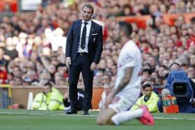 DOWN: Brendan Rodgers (above) looking at a dejected Danny Ings during Liverpool's loss at Old Trafford.