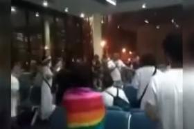 Four Chinese tourists (above) incited everyone to scream China's national anthem after they were told that their flight home from Bangkok airport would be delayed due to bad weather.