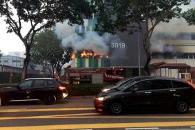 BURNING: The fire was raging at the ground-floor unit and the unit directly above it.