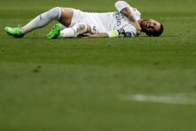 Sergio Ramos lies in on the pitch in pain during Real Madrid's Champions League clash with Shakhtar Donetsk.