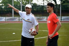 Ikhsan Fandi (right), son of Singapore football icon Fandi Ahmad (left), is based in Chile with Universidad Catolica.