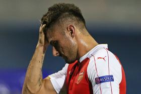 Arsenal were reduced to 10 men after Olivier Giroud was sent off in the 40th minute of their Champions League clash with Dinamo Zagreb.