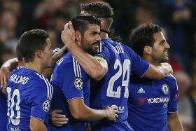 Chelsea striker Diego Costa (middle) celebrates with his team mates after netting his first Champions League goal for he Blues.