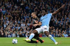 MISFIRING: Wilfried Bony (right) fails to rise to the occasion.