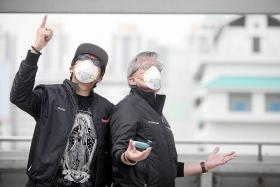 COVERED: ONE FM DJs Glenn Ong and Mark Van Cuylenburg, aka Flying Dutchman, battle the haze with N95 masks and a Ventolin inhaler.