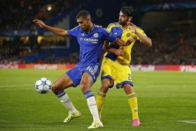 RISING RUBEN: Chelsea's 19-year-old midfielder Ruben Loftus-Cheek (left), one of the Blues' outstanding youngsters, shielding the ball from Maccabi's Omri Ben Harush.