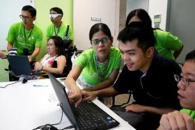 OVERCOMING CHALLENGES: Mr Benjamin Wong, (in black)who has mild intellectual disability, with a team of StarHub employees participating in the SPD Ability Challenge on Thursday.