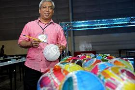 FOR THE RECORD: Mr Ika Zahri (above) will be conducting workshops for batik painting on lanterns at the SingEx Mid-Autumn Festival. The event will attempt to set the Singapore record for the most number of hand-painted lanterns.