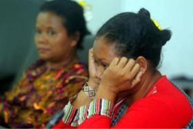 A concerned Orang Asli parent waiting for news of her missing child.