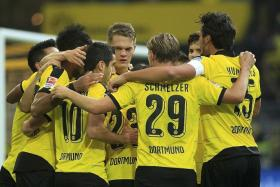 18 - Dortmund (above) have scored an impressive tally of 18 goals from their first five games