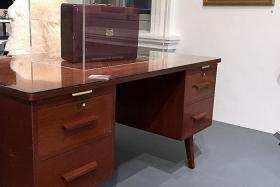 FROM STUDY TO WORK: Mr Lee Kuan Yew's personal desk which started out as a shared table where tuition was conducted for his three children.