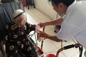 SPECIAL DELIVERY:Madam Wong was one of the residents at Chin Swee Road who got a new doorbell.