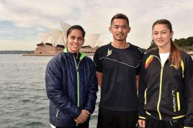 PLAYING SECOND STRING: Women's world No. 1 Saina Nehwal of India (above left), posing in front of the iconic Opera House in Sydney with men's world's No. 3 Lin Dan (centre) of China and Australia's Gronya Somerville (right) in May. Even with stars like multiple world and Olympic champion Lin Dan, Chinese fans are still more likely to tune into the NBA or the English Premier League.