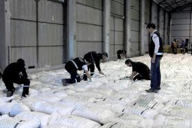 Argentinian officers arranging the 920 bags of rice that had been soaked in cocaine.