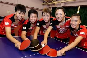 NEW BLOOD: Feng Tianwei (centre) and Yu Mengyu (second from near left) will lead a new-look team comprising teenagers (from far left) Goi Rui Xuan, Eunice Lim and (near left) Yee Herng Hwee.