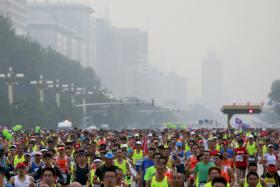 About 30,000 runners participated in the annual running event in China's capital on Sept 20.
