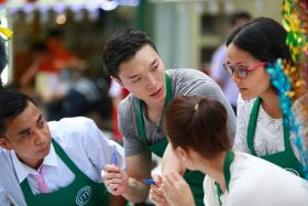Singaporean MasterChef Asia contestant Lennard Yeong (second from left) was in the green team, which cooked Malay cuisine for Lau Pa Sat diners.