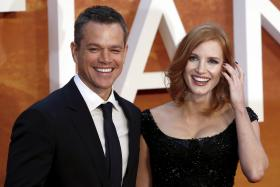Actors Matt Damon (L) and Jessica Chastain arrive for the UK premiere of The Martian at Leicester Square in London, Britain