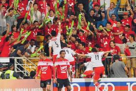 MEMORIES: Baihakki Khaizan (No. 5) celebrating with fans at the King George's Stand after scoring the LionsXII's first goal in their MSL opener against Kelantan in 2012.