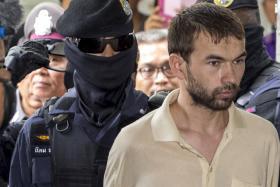 Bangkok blast suspect 'Adem Karadag' escorted by police officers Sept 5, 2015.