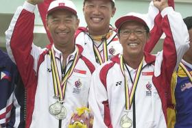 A WINNER IN EVERY SENSE: Chng Seng Mok (far right), with shooting teammates Kwa Eng Cheong (far left) and Lee Wung Yew (centre) after winning the men's trap team gold at the 2001 SEA Games.