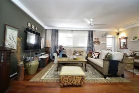 SPACE: Flat owner Mr Ramdzan Minhat designed his own rattan furniture for his jumbo executive flatat Woodlands Avenue 1.