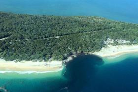 A sinkhole at a camping spot near Queensland's Rainbow Beach swallowed several vehicles.