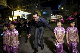CULTURAL EXCHANGE: Australian actor Hugh Jackman at the Tai Hang Fire Dragon Dance event in Hong Kong where he was the guest of honour.