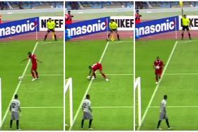 Screengrabs of Al Ahli defender Salmin Khamis picking up the ball.