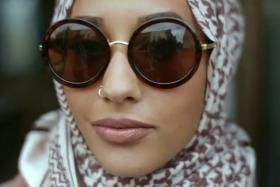 """Mariah Indrissi appears in H&M's video for its """"Close the Loop"""" Campaign. She is H&M's first Muslim model in who wears hijab."""