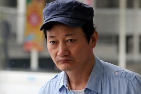 SNEAKY: Lee Bok Yeon put two mobile phones in his shopping basket and placed it near the skirt of his victim.