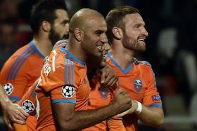 VIVA VALENCIA: (From right) Valencia's Shkodran Mustafi, Sofiane Feghouli, Aymen Abdennour and Alvaro Negredo celebrating Feghouli's winner against Lyon.