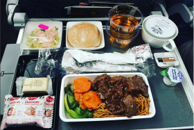 An Instagram photo by @kokpowa of fried noodles and braised beef on Singapore Airlines.