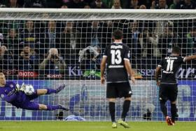 """""""We didn't play well. We were really disjointed and have been in the last couple of games in the Premier League that we've lost."""" - Man City goalkeeper Joe Hart (left, saving a penalty from Moenchengladbach's Raffael, right)"""