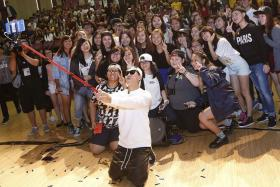 MAKING MEMORIES: Korean star Gary Kang of Running Man fame takes a selfie with students from Singapore Polytechnic when he paid the students a surprise visit yesterday.